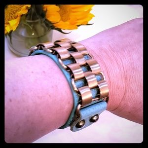Leather cuff with gold details and hardware